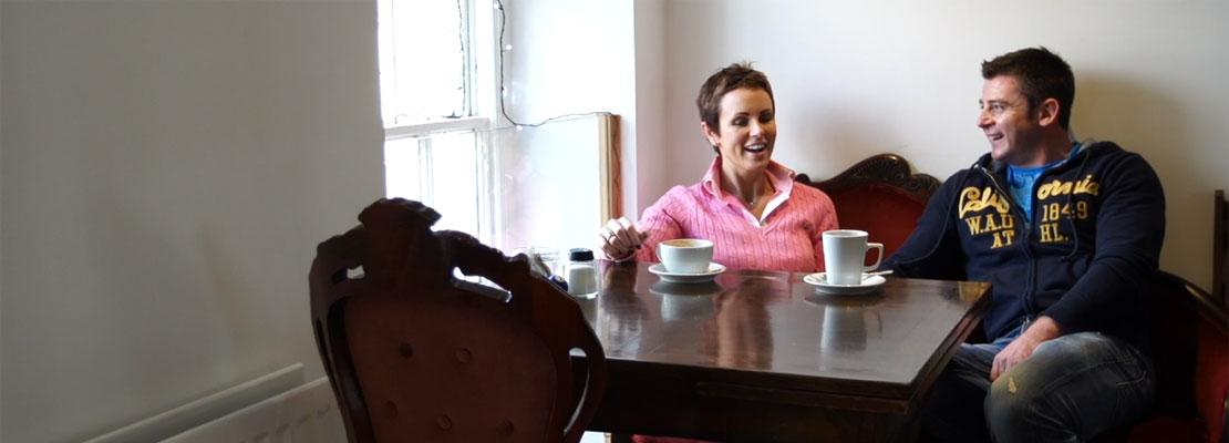 Suzanne McTurk and her husband sitting in a coffee shop